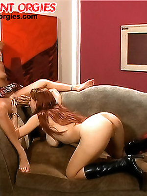Two lesbians eat pussy when a cock joins in