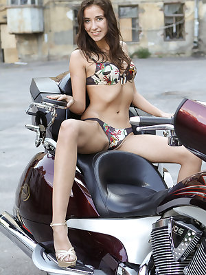 You know that biker babes are always up to some crazy stuff and this slim long legged beauty is not an exception