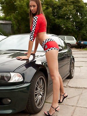This lustful hottie bends over the car and fucks her juicy slit till her legs start shaking from overwhelming pleasure