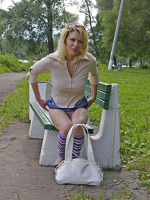 Using a vibrator on a park bench