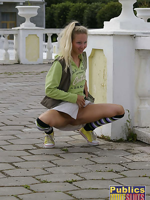 Eva squats quickly to show it all