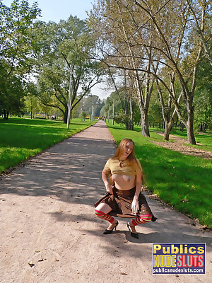 Very sexy redhead flashing in the park