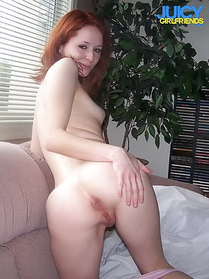 Nice redhead girl loves to show her cunt close up