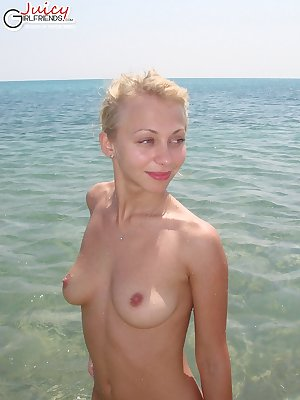 Pretty nude blonde on a public beach