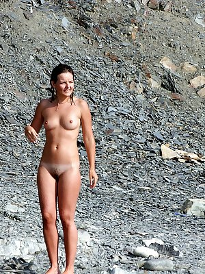 Gorgeous brunette model filmed posing nude in public