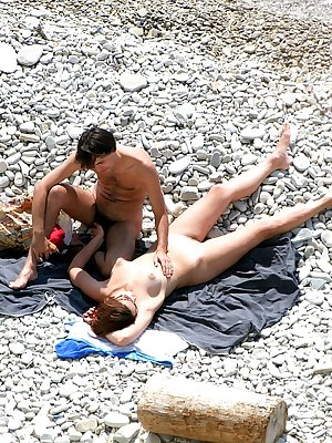 Young couple filmed naked at the nudist beach