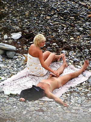 Two hot chicks are filmed naked while sun tanning