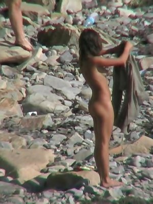 Wonderful models are exploring the beach together naked