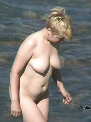 Chubby mature blond nude in shallow waters