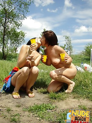 Drunk naked babes take a piss at the public beach. So shameless!