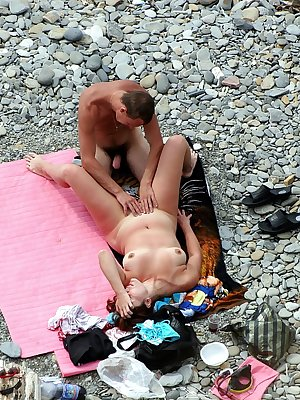 Lucky guy playing with gf's pussy on the publick beach