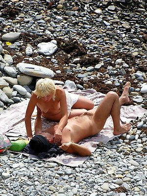 Horny couple enjoing sun and sex on the beach