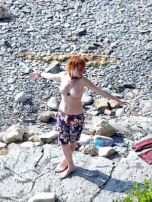 sexy redhead girl totally naked at the beach