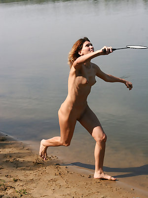 Some guys and girls get together for a game of naked badminton while at a nude beach